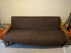 Three seater oak framed futon sofa bed.