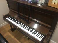 Piano - Upright lovely dark wood finish.