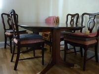a large extendable mahogany dinning table for sale 120 pounds