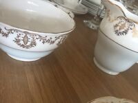 Milk jug and sugar bowl.