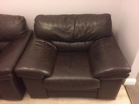 2 black leather armchairs in decent condition.