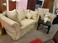 Patterned fabric two seater sofa with matching armchair