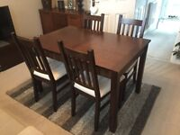 Extending dark wood dining table and four chairs