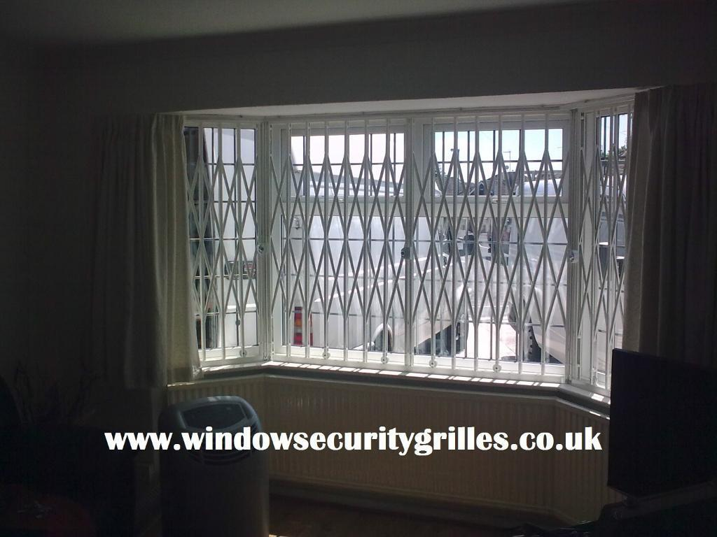FOLDING CONCERTINA SECURITY GRILLES FOR WINDOW DOOR COLLAPSIBLE GATES  SHUTTER SHUTTERS GRILLE GATE   In Derby, Derbyshire   Gumtree