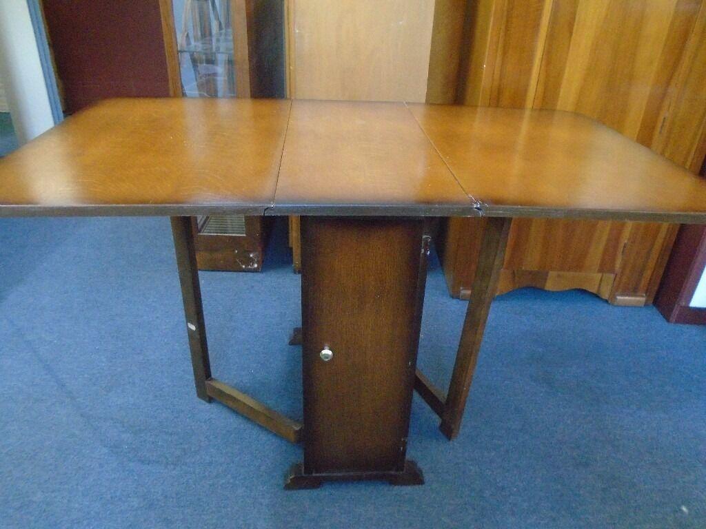 Vintage Dark Wood Drop Leaf Table With Cupboard.