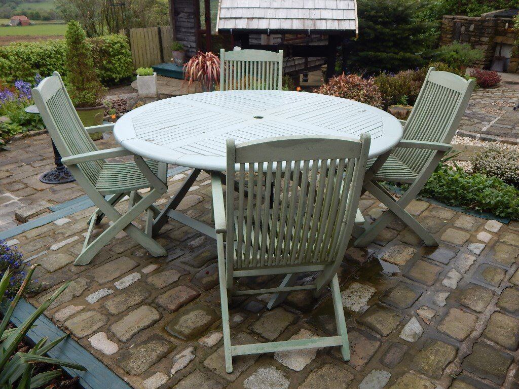 solid hardwood round patio table with 4 chairs