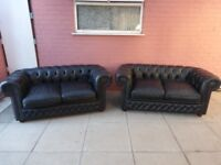 A Pair Of Black Leather Chesterfield 2 X 2 Seater Sofas