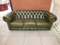 A Green Leather Chesterfield Three Seater Sofa