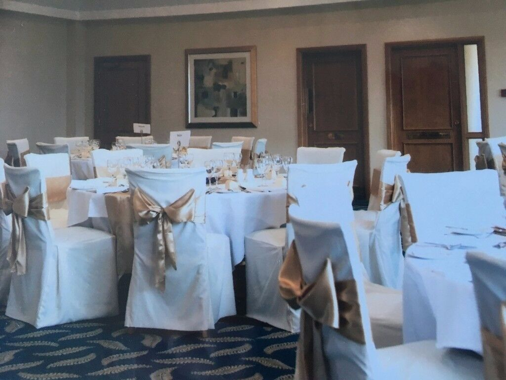 Charmant Cream Chair Covers, Gold Sashes And Mirror Tile Table Decorations Suitable  For Wedding Reception