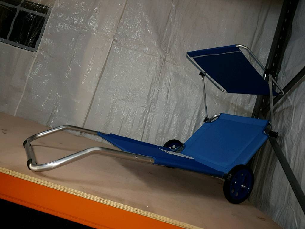 A brand new light weight folding sunbed on wheels with sun canopy. : light weight canopy - afamca.org