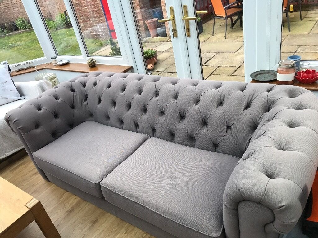 light grey fabric sofa for sale excellent condition but faded mark from fire label