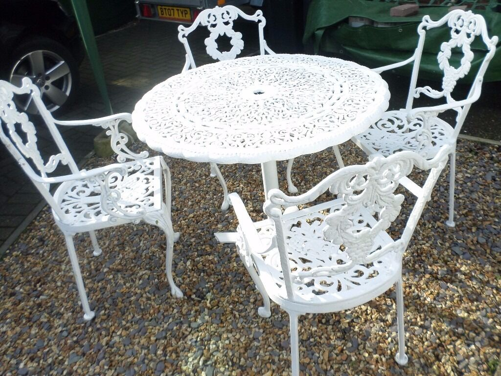 LOVELY OLD CAST METAL GARDEN TABLE AND 4 CHAIRS & LOVELY OLD CAST METAL GARDEN TABLE AND 4 CHAIRS | in Christchurch ...