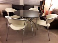 Calligaris Round Glass Dining Table And 4 Cream Wing Chairs