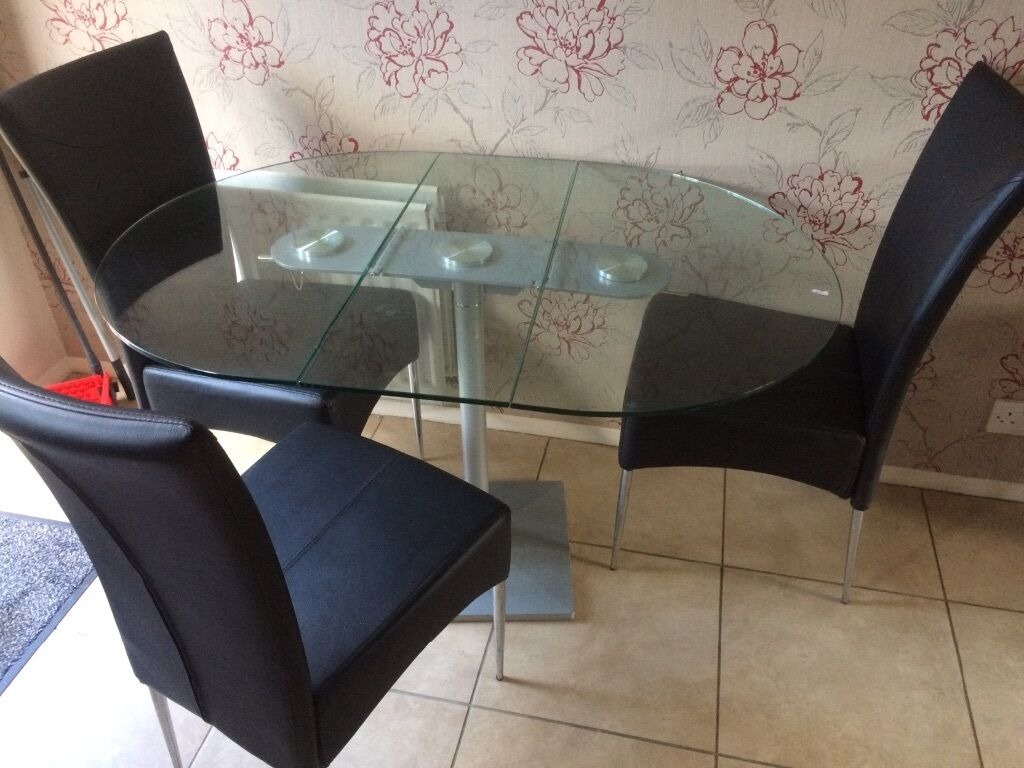 Dwell Glass Butterfly Folding Table And Four (4) Black Leather Chairs