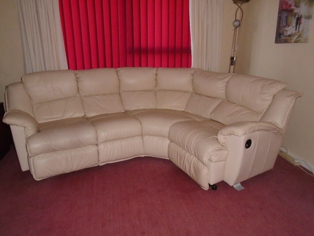 Large Cream Leather Five Sectioned Sofa With Reclining Ends.