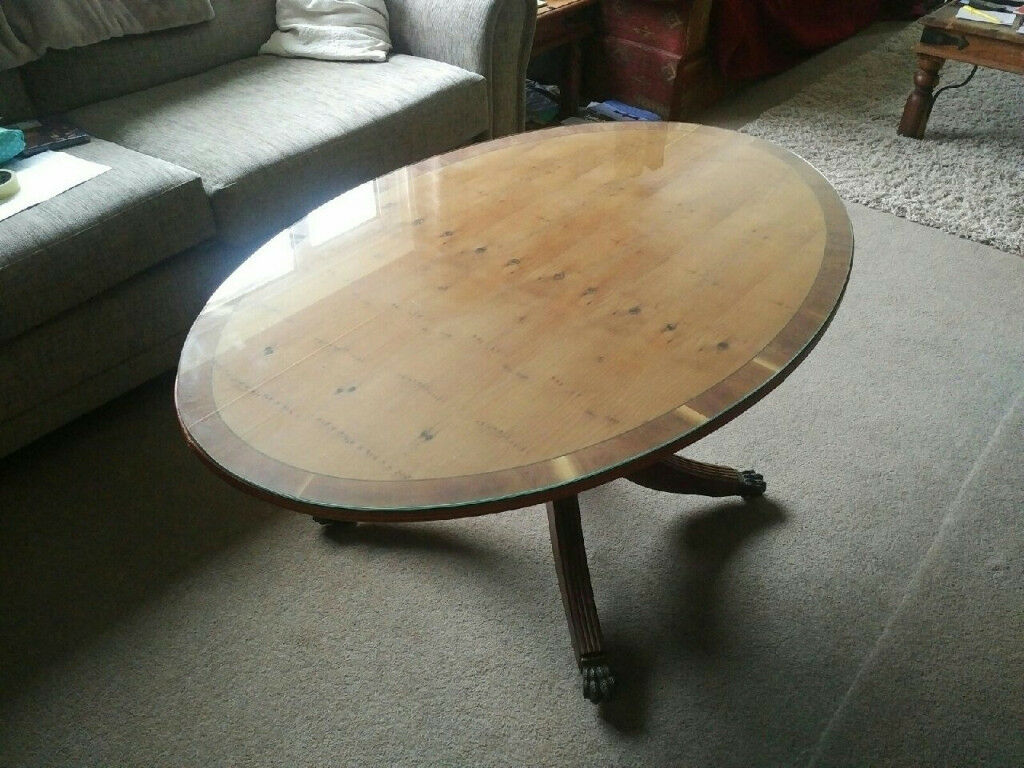 Wooden Inlaid Detail   Oval Shaped Coffee Table With Glass Top And Ornate  Legs