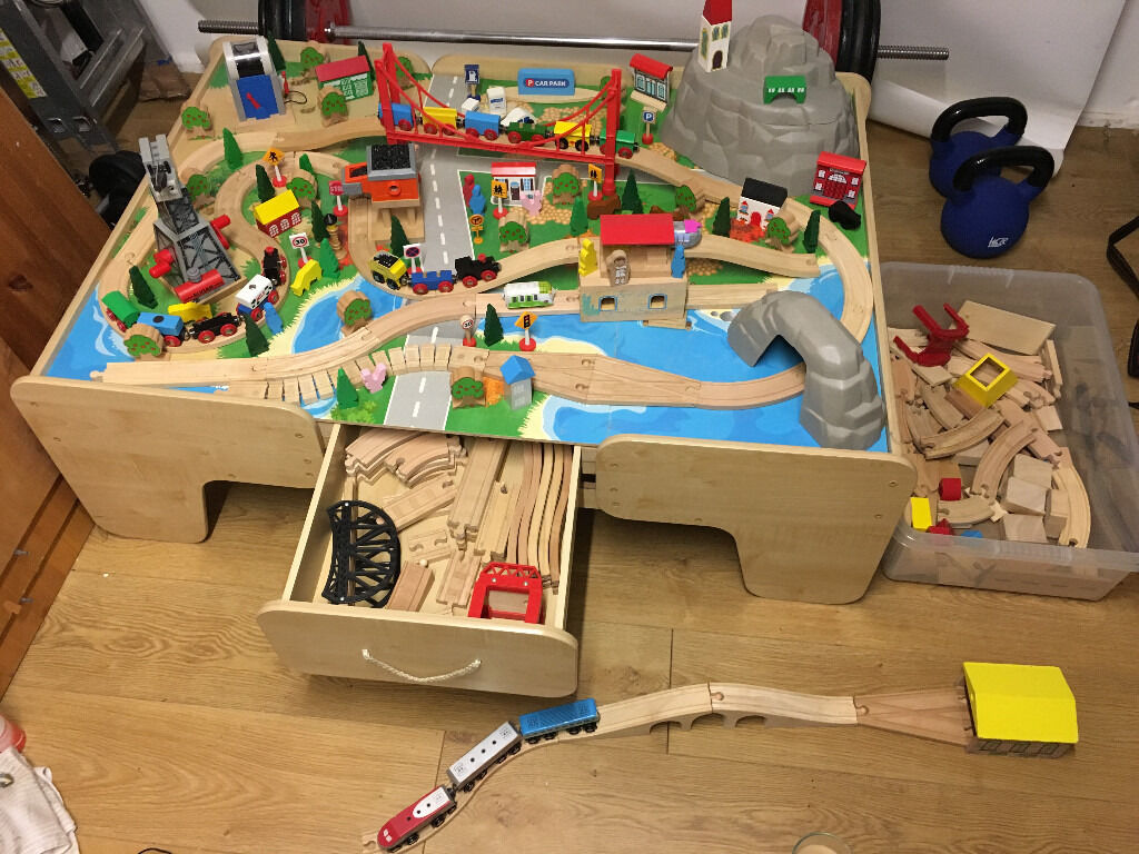 Play table with wooden train set and toys including some thomas tank engine large pieces. & Play table with wooden train set and toys including some thomas tank ...