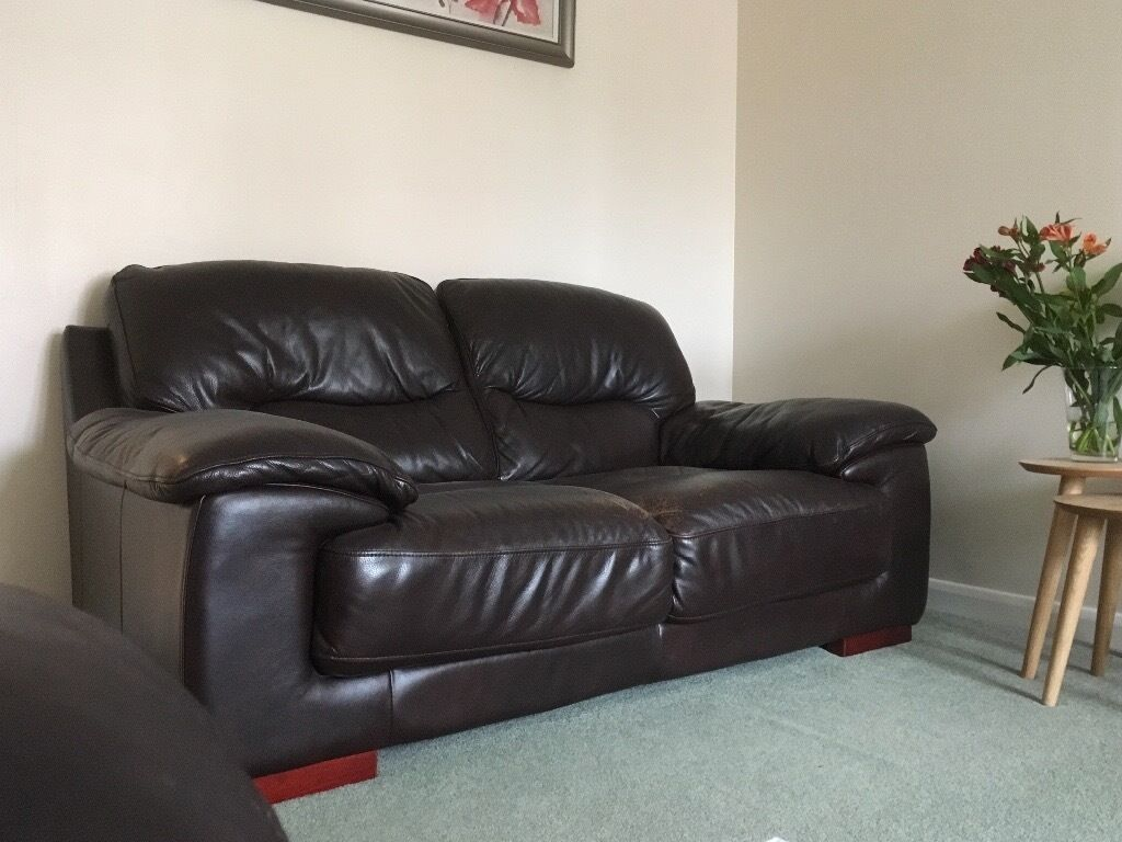 Two, Two Seater Brown Leather Sofas.... 3 Years Old From DFS