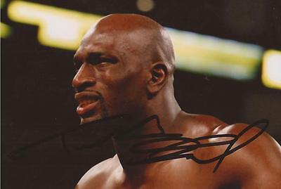 WWE WRESTLING: TITUS O'NEIL SIGNED 6x4 ACTION PHOTO+COA