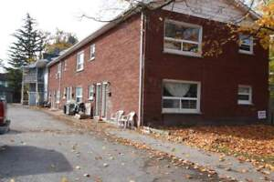 2 bdrm with on-site laundry! Along bus route to college.