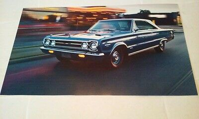 (1967 Plymouth Hemi GTX Muscle Car Picture Poster Single Page from a new Calendar)