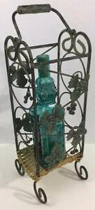 Beautiful Wine Rack With Ivy Detailing & A Vintage Blue Glass Bottle