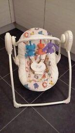 Motorised baby swing / seat / chair - Plays music and rocks baby to sleep.