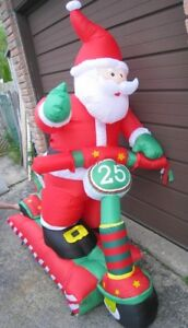 Brand New Large Inflatable Waving Santa on a Scooter