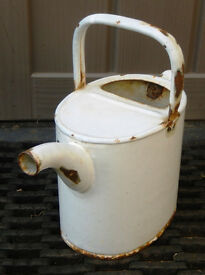 Vintage watering can in White Enamel holds about 6 pints. Nicely aged & with no leaks.