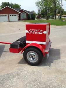 Coke trailer with pop up shelter storage