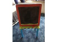 Double sided easel with letter and number magnets