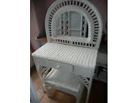 White wicker dressing table with drawer and matching stool plus white wicker low side table.