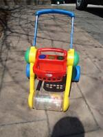 Childs Push Activity Toy with Lights and  roller full of objects