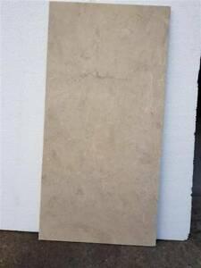 Cream marble (Natural stone) tiles 610 x 305 x 12 mm; $30 /sqm
