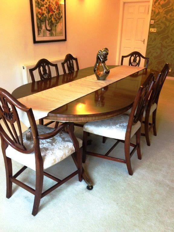 Bevan funnell mahogany dining table with leaf storage and