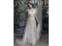 Ian Stuart designer wedding gown in Midsummer Dream. Never been worn, UK size 12, champagne colour.