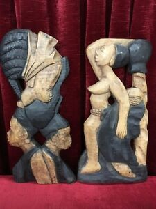 2 Hand Carved Wood Tribal Plaques
