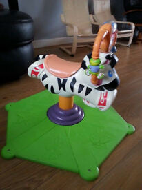 Bounce and Spin Zebra – in good condition, although a bit faded on the seat from the sun