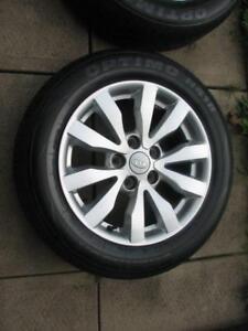 Hankook H418 All season tires on rims