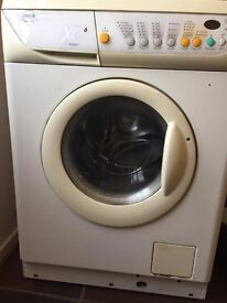 Zanussi washer dryer free to collect for spares, in working order but small door leak, some rust