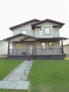 5 Bedrooms, 2 Kitchens, Separate Basement Entrance! LIKE NEW!