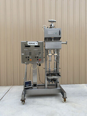 Serac 2237 Dual Head Semi-automatic Electronic Net Weigh Liquid Filler