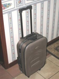 "Small 20"" Carry-on Luggage on wheels with lock, good condition"