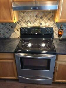 Stainless Steel Kenmore electric range with self-cleaning oven a