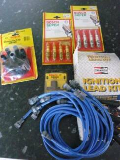 Bundle of asst carparts -plug leads, plugs,dist cap, rotor, to