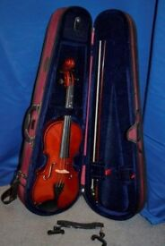 Violin by Stentor, half size with rest, red case