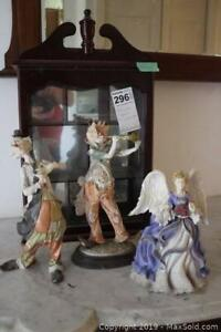 Display Case And Figurines. A