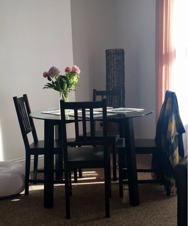 Dinning table and chairsin Swindon, WiltshireGumtree - For sale circle glasses table and fours chairs, black. Great condition bargain price! First come first served. Delivery
