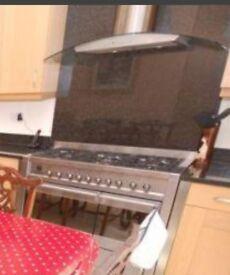 Smeg cooker, black granite splashback, extractor hood