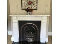 Cast iron fireplace with Granite surround and base
